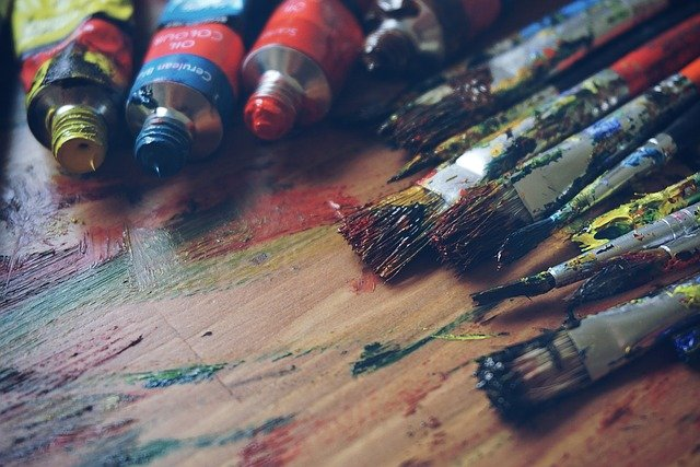 paint brushes on art board